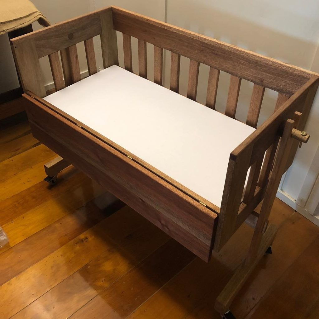 This sustainable gift is a wooden baby craddle, DIY woodworking at its best
